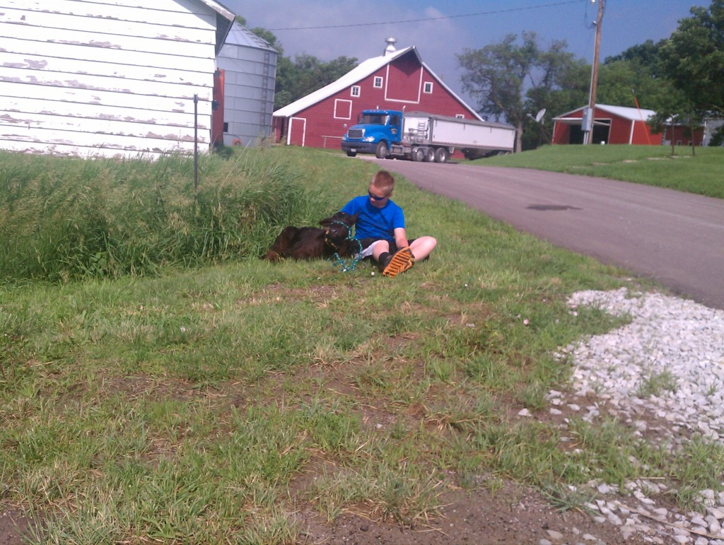 As I rode up I thought this was a boy with his dog.  No!  It was a one month old calf.  Cutest thing, real curious, actually reminded me of a puppy.